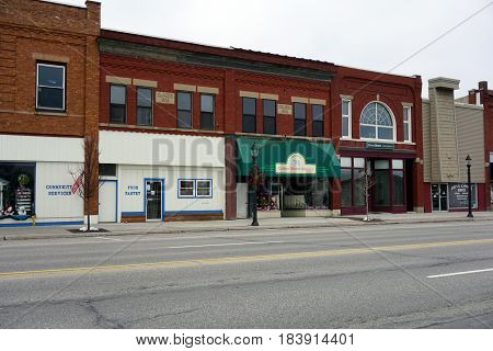 KALKASKA, MICHIGAN / UNITED STATES - NOVEMBER 27, 2016: Some of the principal businesses in downtown Kalkaska include the Kalkaska Area Interfaith Resources (KAIR) Food Pantry, the Cedar Street Sweets Bakery, and Edward Jones Investments.