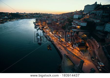 Views of Douro river and Ribeira from Dom Luis I Bridge at night time, Porto, Portugal.