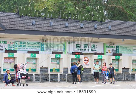 TAIPEI TAIWAN - DECEMBER 8, 2016: Unidentified people buy admission for Taipei Zoo. Taipei Zoo is a public zoological garden and one of the most popular tourist