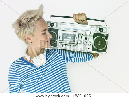 Caucasian woman smiling and holding stereo