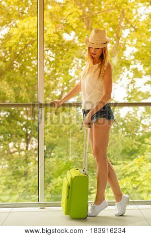 Attractive Woman Tourist With Suitcase Relaxing After Trip