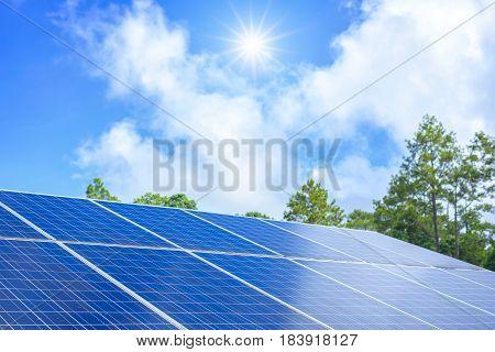 Blue solar panels and sun on blue sky