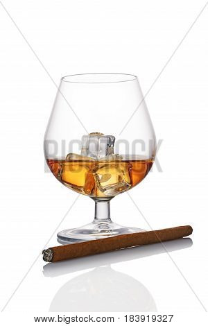 Glass Of Strong Alcoholic Drink Scotch Whiskey With Ice Cube And Cigar