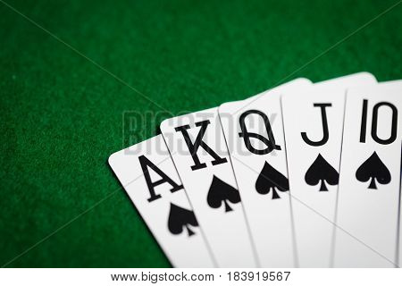 casino, gambling, games of chance, hazard and entertainment concept - royal flush poker hand of playing cards on green cloth