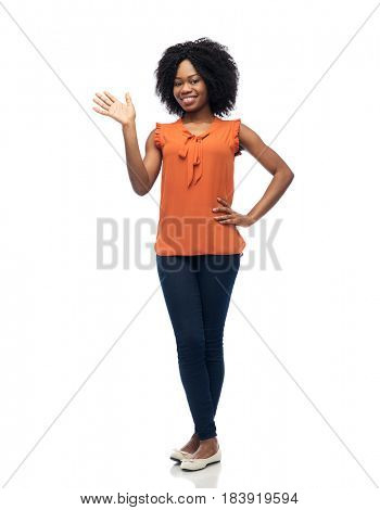 people, race, ethnicity and gesture concept - happy african american young woman waving hand over white