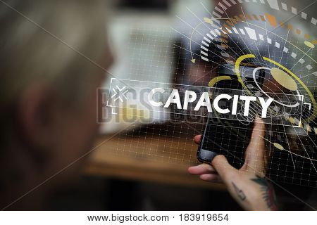 Capacity word graphic design with woman using mobile photo