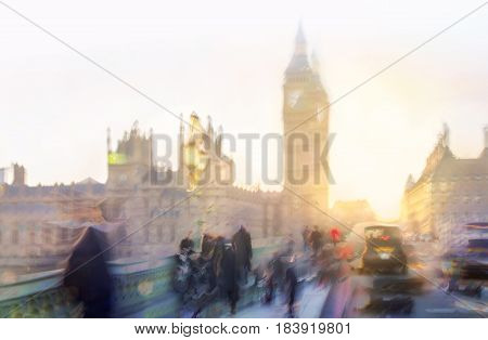 Sunset at Westminster bridge, Blur of walking people, Big Ben and houses of parliament. London. Multiple exposure image