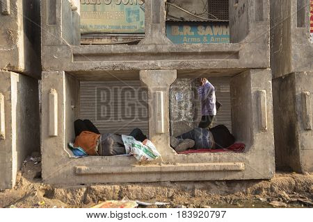 DELHI INDIA - MAR 21 : tramp man sleep in concrete block at chandni chowk in old delhi. old delhi is famous place of Delhi on march 21 2015 india