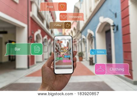 Augmented Reality Marketing Street . Hand Holding Smart Phone Use Ar Application To Check Informatio