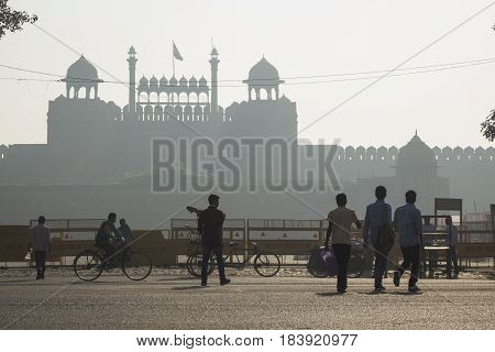 DELHI INDIA - MAR 21 : people scene in front of red fort (Lal Qila) in late in morning. red fort is world Heritage site of delhi on march 21 2015 india