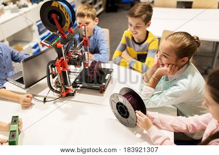 education, children, technology, science and people concept - group of happy kids with 3d printer and laptop computer at robotics school lesson