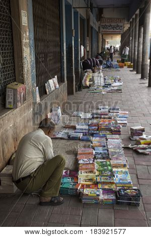 DELHI INDIA - JUN 7 : unidentified person setup book stall on floor in darya ganj of delhi on june 7 2015 india. this market is open in sunday only it call sunday market.