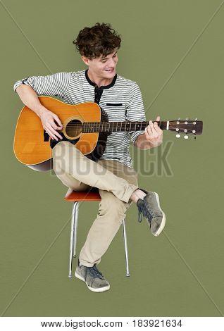 Man guitarist player sitting and playing guitar