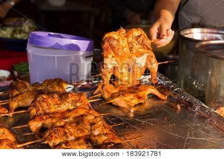 cooking, asian kitchen, people and food sale - quail grill on street market