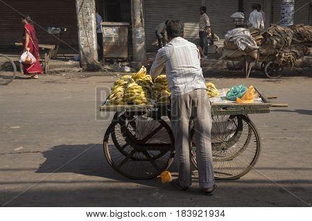 DELHI INDIA - MAR 21 : banana stall in spice market in morning. shop in spice market is close in morning of delhi on march 21 2015 india