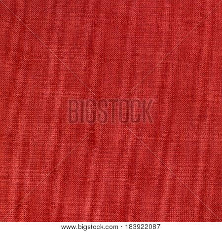 Red canvas texture seamless with copy space