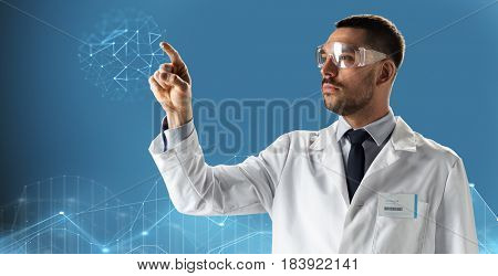 medicine, science, healthcare and people concept - male doctor or scientist in white coat and safety glasses pointing finger to low poly projection over black background
