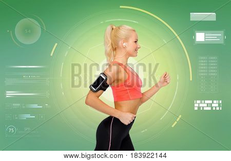 sport, exercise, technology, internet and healthcare - smiling sporty woman running with smartphone and earphones and listening to music over green background