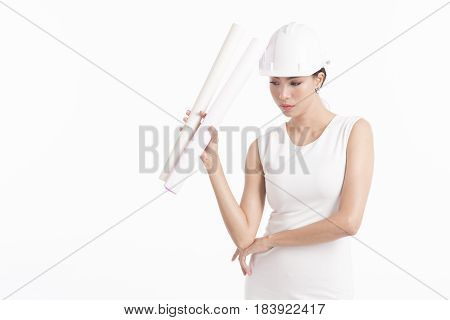 Sexy girl structural engineer holding drafting paper with copy space for product or text white background photo
