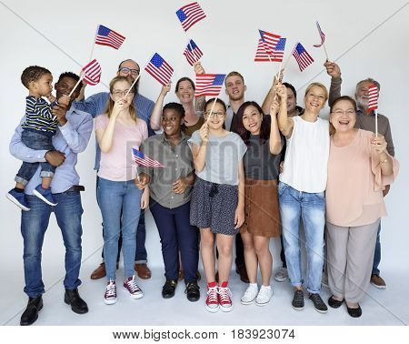 Group of people holding american flag studio portrait