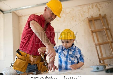 Worthy Grandfather And Grandson In A Carpenter's Workshop