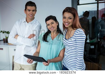 Portrait of graphic designers  holding digital tablet in creative office
