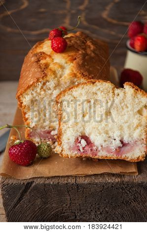 Strawberry Yogurt Fluffy Pound Cake With Fresh Berries On A Parchment Paper On A Wooden Board.