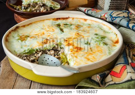 Young Cabbage Lasagna Stuffed With Vegetables And Rice With Bechamel  Sauce In Ceramic Dish On A Woo