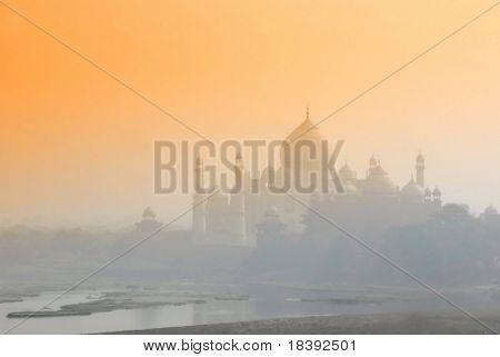 worldwonder taj mahal in early morning fog by sunrise
