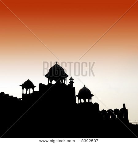 silhouette of the red fort by sunrise in delhi, India