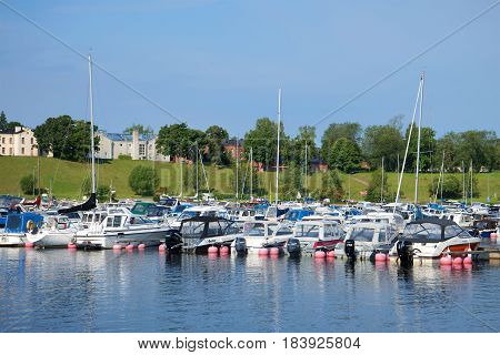 LAPPEENRANT, FINLAND - AUGUST 21, 2016: Parking of small size water transport on Saimaa lake on a sunny August morning