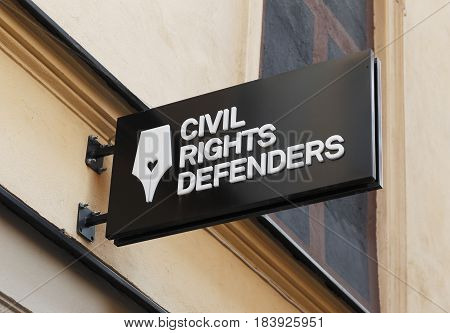 Stockholm Sweden - August 4 2014: The sign above the entrance to the organization Civil Rights Defenders office at the street Stora Nygatan.