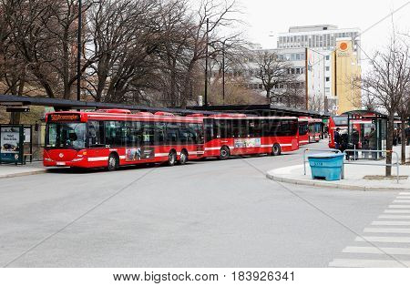 Solna Sweden - April 20 2017: City busses the Solna city center public transportation hub.