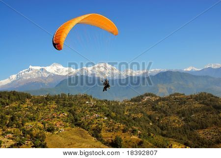 paragliding in nepal with himalaya view and clear blue sky