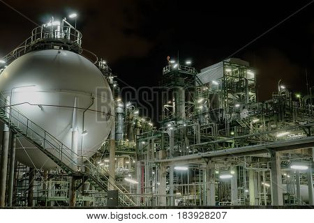 Petrochemical plant and light on night background.