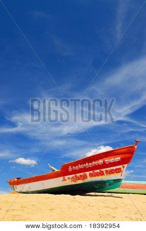 Colorful painted fishing boat on Mahabalipuram beach, India