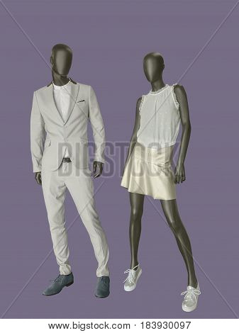 Full-length two mannequins male and female dressed in fashionable clothes isolated. No brand names or copyright objects.