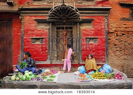 colorful market scene in front of a little temple in the streets of kathmandu, nepal