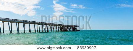 Sea pier in  warm summer sea, summer background
