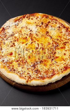 Hot Pizza Quattro Formaggi On A Rustic Wooden Table.