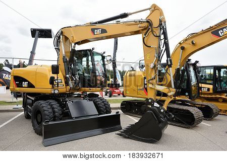 VILNIUS LITHUANIA - APRIL 27: Caterpillar M313D Mobile Excavator on April 27 2017 in Vilnius Lithuania. Caterpillar is a leading manufacturer of construction equipment.