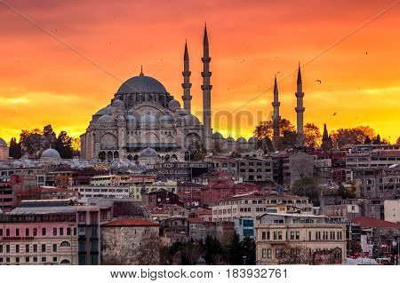 Suleymaniye Mosque shot at beautiful red sunset, Istanbul, Turkey.