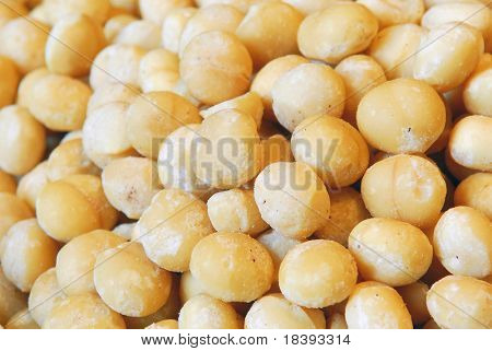 Background filled with salted macadamia nuts