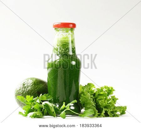 Fresh green organic smoothie , from avocado