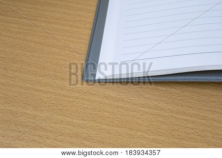 The notebook at wood with a background