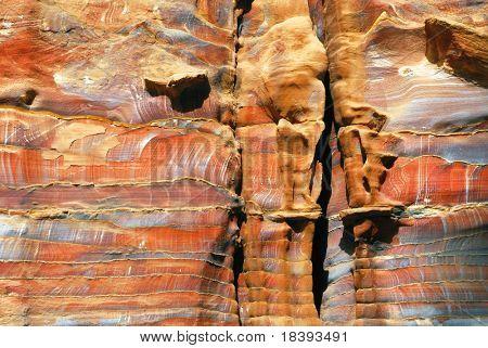 Abstract layered sandstone wall in world wonder Petra, Jordan