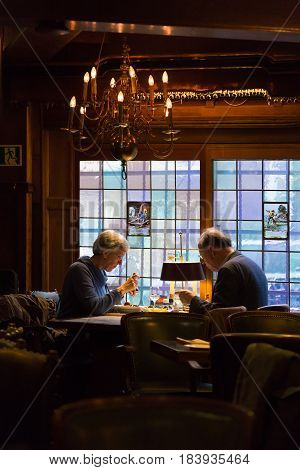 Amsterdam The Netherlands - 11 April 2017 - Elderly European couple enjoy their dining together at a romantic restaurant in Amsterdam The Natherlands on April 11 2017.