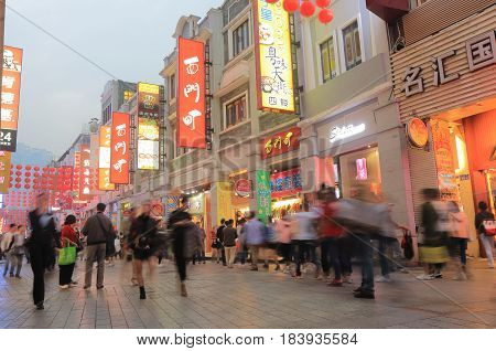 GUANGZHOU CHINA - NOVEMBER 12, 2016: Unidentified people visit Shangxiajiu pedestrian street. Shangxiajiu is the first business street in Guangzhou opened in 1996