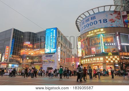 GUANGZHOU CHINA - NOVEMBER 12, 2016: Unidentified people visit Shangxiajiu pedestrian street. Shangxiajiu is the first business street in Guangzhou opened in 1997