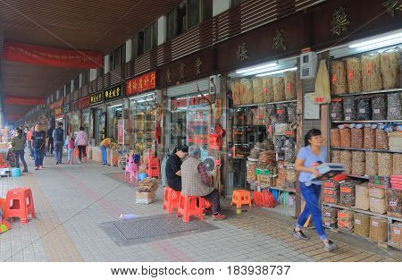 GUANGZHOU CHINA - NOVEMBER 13, 2016: Unidentified people visit Qing Ping street market.